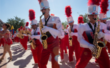 thumbnail image of marching band members playing saxophones