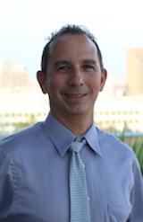 Headshot of Forklift Danceworks Board Member Manuel Flores